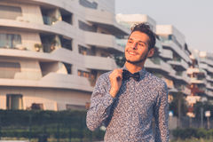 Young handsome man posing in the city streets Stock Image