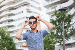 Young handsome man posing in the city streets Royalty Free Stock Image