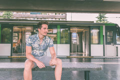 Young handsome man posing in a metro station Royalty Free Stock Image