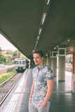 Young handsome man posing in a metro station Stock Image