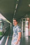 Young handsome man posing in a metro station Stock Photos