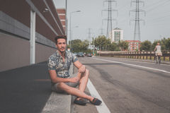 Young handsome man posing in the street Royalty Free Stock Photography
