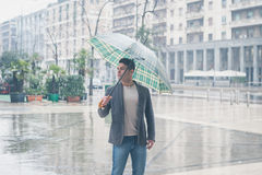 Young handsome man posing with umbrella Royalty Free Stock Images