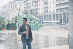 Young handsome man posing with umbrella Royalty Free Stock Photo