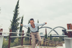 Young handsome man posing in an urban context Stock Image