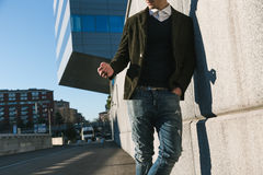 Young handsome man posing in an urban context Stock Photo