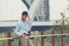 Young handsome man posing in an urban context Royalty Free Stock Photography