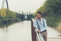 Young handsome man posing in an urban context Royalty Free Stock Photo