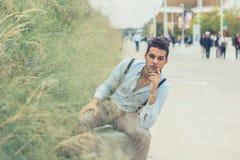 Young handsome man posing in an urban context Royalty Free Stock Photos