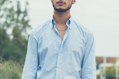 Young handsome man posing in an urban context Royalty Free Stock Images