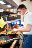 Young handsome man preparing dinner Stock Photo
