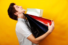 Young handsome man with presents Royalty Free Stock Image