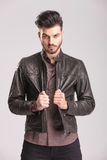Young handsome man pulling his leather jacket Stock Photo