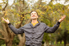 Young handsome man with raised arms Royalty Free Stock Image