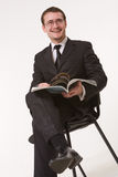 Young handsome man reading magazine Royalty Free Stock Images