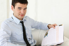 Young handsome man reading magazine Stock Photo