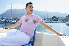 Young handsome man relaxed on a boat Stock Photography