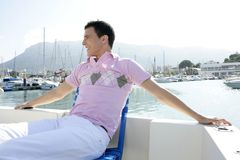 Young handsome man relaxed on his boat Royalty Free Stock Image