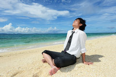 Young Handsome Man Relaxing on Beach Royalty Free Stock Photo