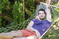 Young handsome man Relaxing In Hammock Royalty Free Stock Photography