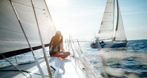 Young handsome man relaxing on his sailboat Royalty Free Stock Photos