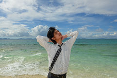 Young Handsome Man Relaxing on Tropical Beach Stock Photo