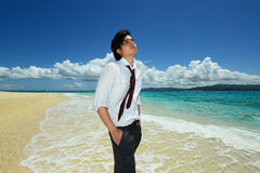 Young Handsome Man Relaxing on Tropical Beach Stock Photography