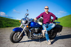 Young handsome man with retro motorcycle Stock Photos