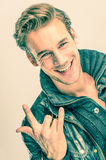 Young handsome Man with Rock and Roll gesture Royalty Free Stock Photo