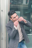 Young handsome man rolling a cigarette Stock Photo