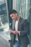 Young handsome man rolling a cigarette Stock Photography