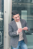 Young handsome man rolling a cigarette Stock Image
