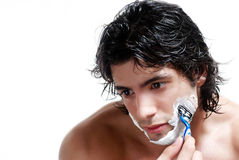 Young handsome man shaving Royalty Free Stock Images