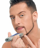 Young handsome man shaving Stock Images
