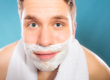 Young handsome man with shaving cream foam. Stock Photos