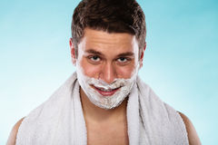 Young handsome man with shaving cream foam. Royalty Free Stock Photography