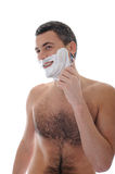 Young handsome man shaving in the morning Royalty Free Stock Photo