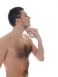 Young handsome man shaving in the morning Stock Image