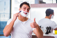 The young handsome man shaving in the morning Royalty Free Stock Image