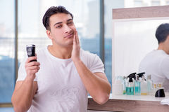 The young handsome man shaving in the morning Royalty Free Stock Images
