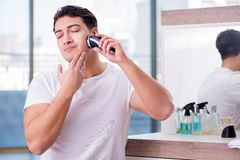 The young handsome man shaving in the morning Stock Image