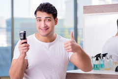 The young handsome man shaving in the morning Stock Photos