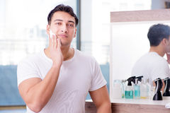 The young handsome man shaving in the morning Royalty Free Stock Photo