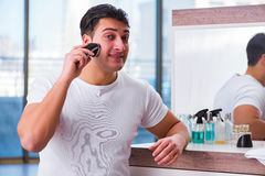 The young handsome man shaving in the morning Stock Photography