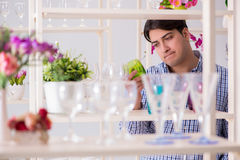 The young handsome man shopping in shop Royalty Free Stock Photos