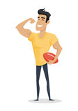 Young Handsome Man Show His Biceps Arm. Young handsome man with ball show his biceps arm. Smiling muscular athlete in flat. Young man in front shows a trained Stock Photo