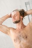 Young handsome man in shower Royalty Free Stock Photos