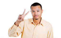 Young handsome man showing peace or victory sign Stock Photography