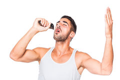 Young handsome man singing at his trimmer Stock Photos