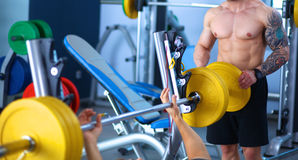 Young handsome man sits after workout in the gym Royalty Free Stock Photography